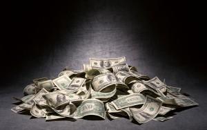 us-money-with-black-backdrop